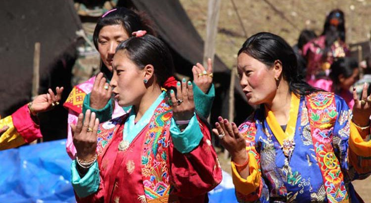 Women sing and dance at the festival
